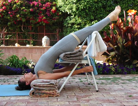 Supported Shoulderstand with Chair. a key pose for restoring energy reserves and  balancing the endocrine system.  Photo Credit: Radames Pera. Model: Marsha Mann